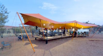 Guests relax on the Larapinta Trail - Semi-Permanent Stretch Tent - Photo by Neeson Murcutt Architects
