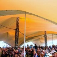 multiple stretch tents installed with truss poles and joining strips