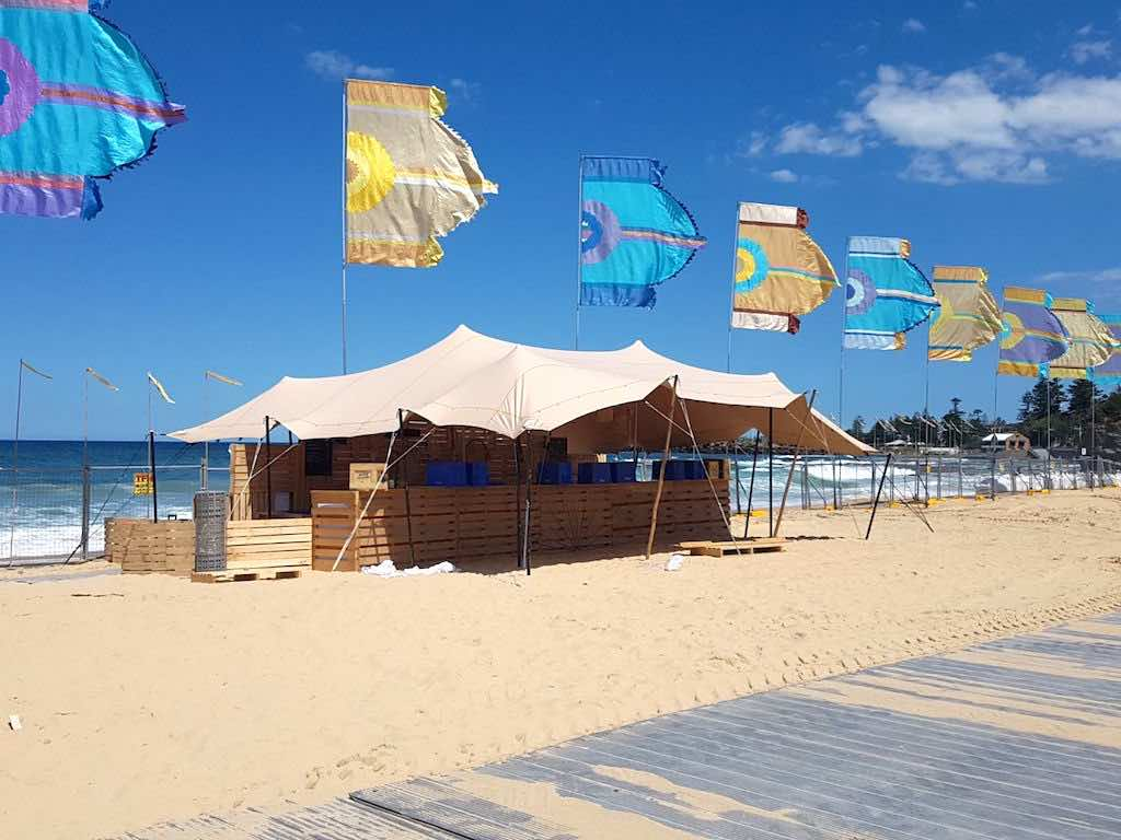 Corona SunSets Festival - stretch tent installation on sand
