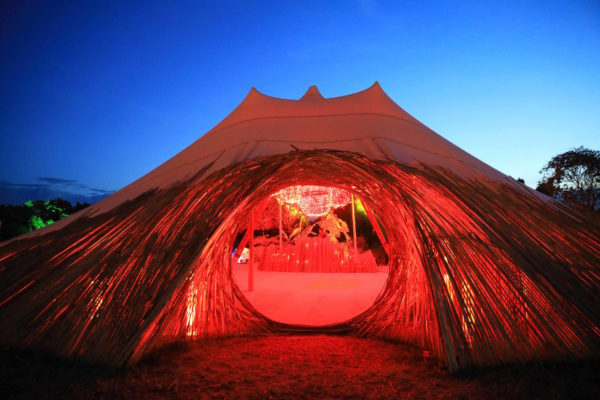 Wonderfruit - versatile festival tents - sand stretch tent infused with red light