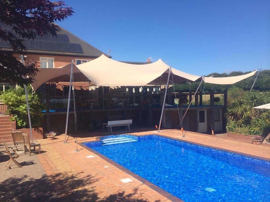 stretch tent installed over balcony and pool area
