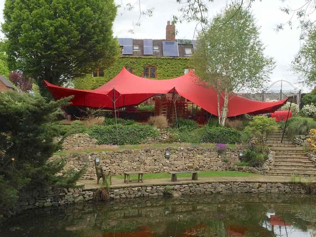 covered by canvas - stretch tent installed over tiered garden