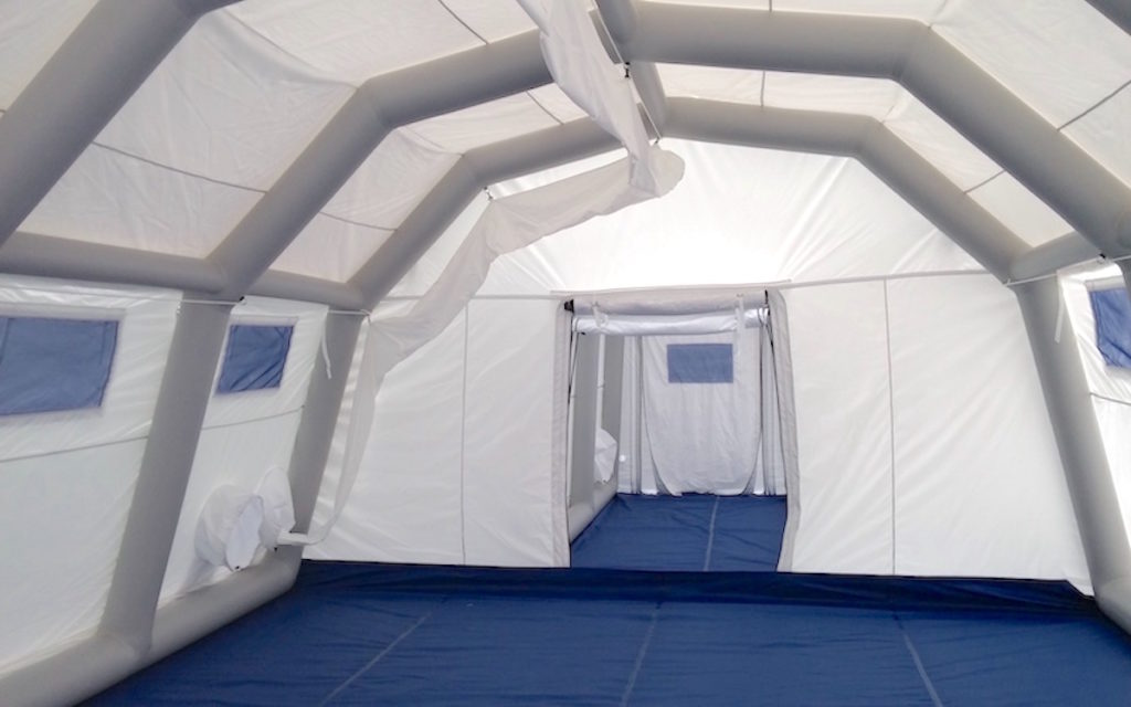 Negative pressure inflatable structure for medical or industrial use