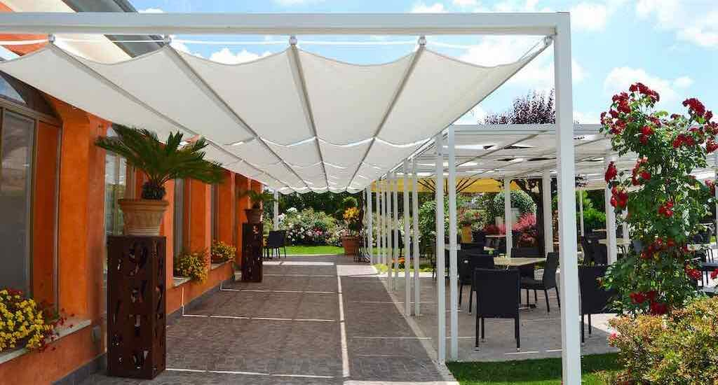 ONDA and KUBE Lite framed shade structures installed at a restaurant