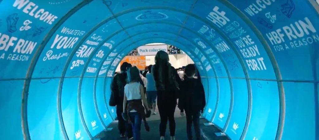 Stretch tunnel for social distancing queues