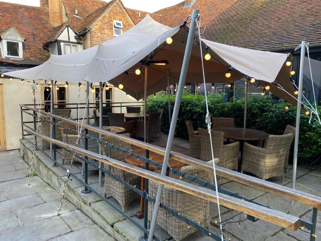 The Thatch gastro pub using stretch tent for outdoor terrace cover
