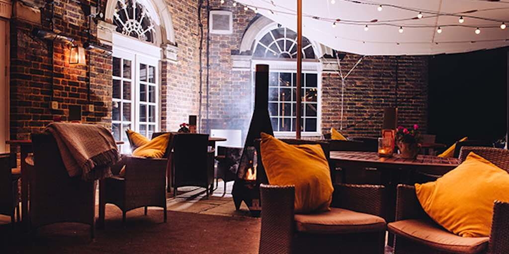 Brookmans pub stretch tent keeping patrons warm on the terrace - pub outdoor cover