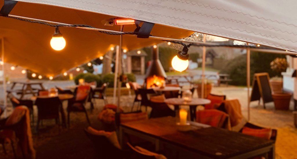 Swan pub using stretch tents for outdoor cover