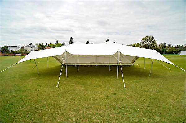 White 9m x 12m stretch tent 1 side down